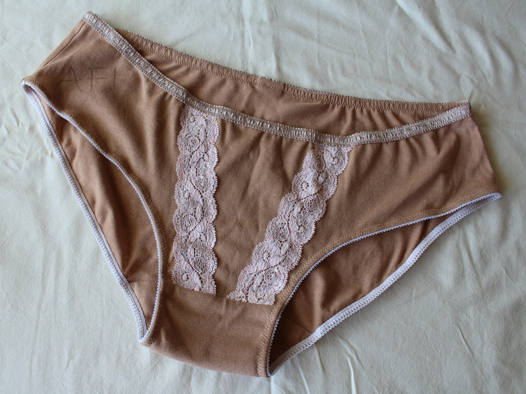 Nude panties with pink lace